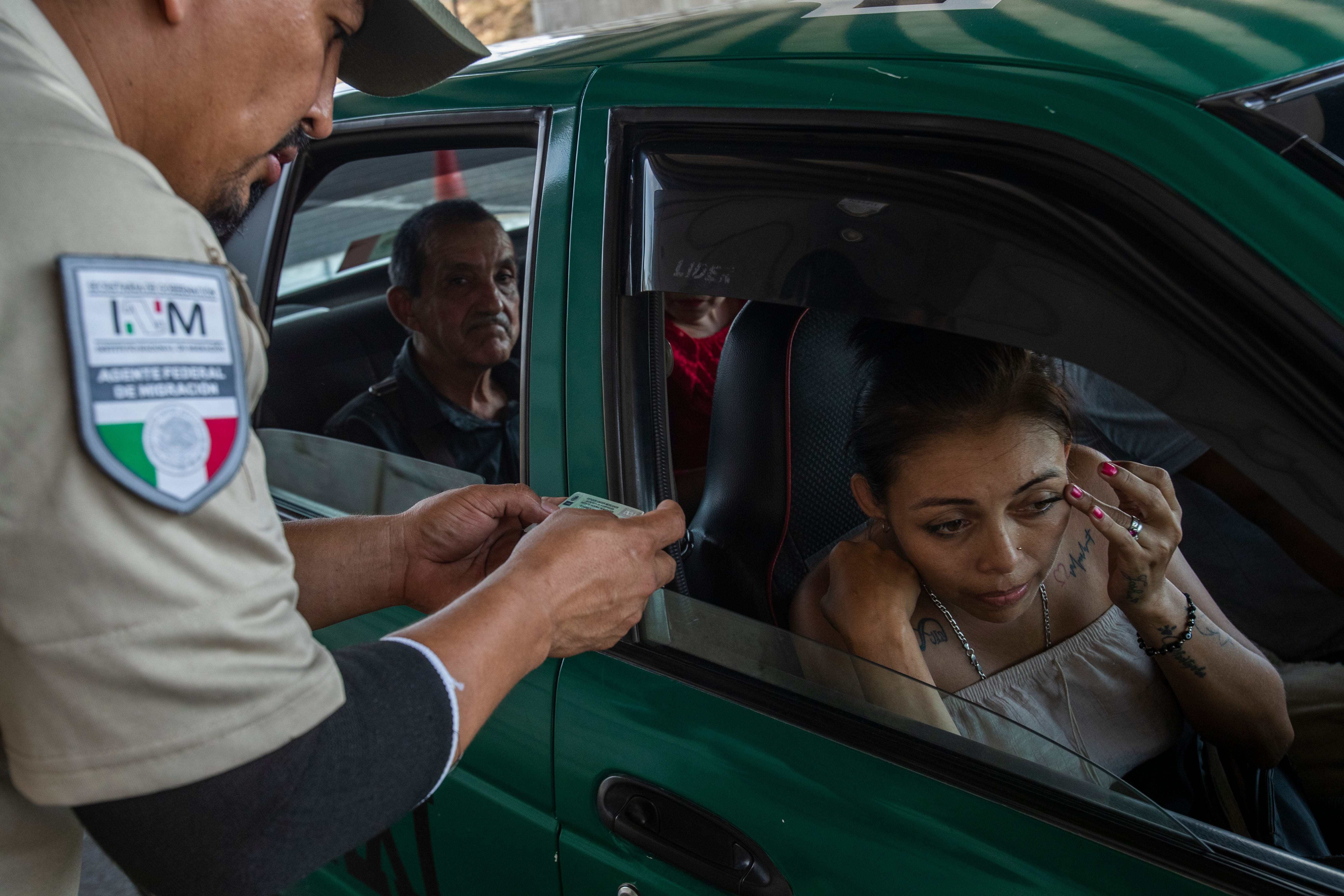 A Mexican immigration agent mans a checkpoint on a federal highway between the border crossing of Ciudad Hidalgo and Tapachula an hour north in late February.