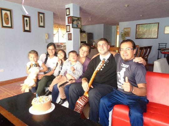 Gordon Haskell, second from right, spends time with a family during his Mormon mission in Ecuador. They helped him celebrate his birthday.
