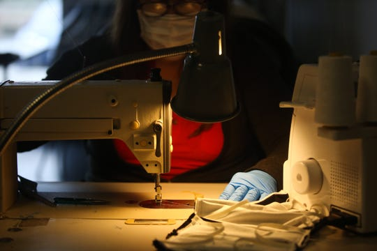 Ernie Ball employee Ruth Fuentes sews face masks on Thursday, April 9, 2020 in Coachella, Calif. during the coronavirus outbreak.