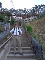 """Gordon Haskell, while on his Mormon mission in Ecuador, gets ready to climb what he called """"the longest set of stairs he's ever seen"""" in already high elevations of Ecuador."""