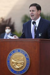 Gov. Doug Ducey speaks with an update on COVID-19 during a press conference outside of St. Luke's Medical Center in Phoenix, Ariz. on April 9, 2020.