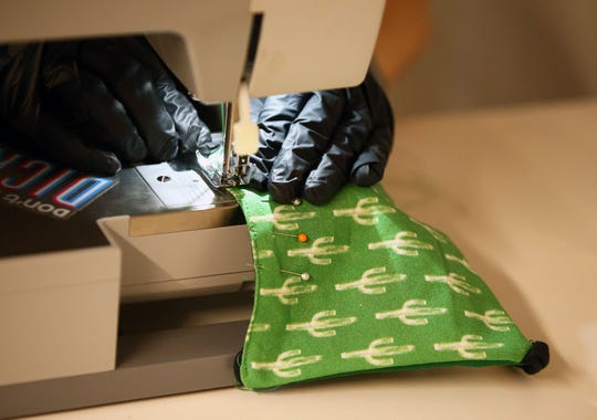 Sewing machines are out of stock in many stores. People are buying them to make their own masks at home.