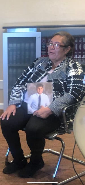 María Santibañez holds a photo of her grandson, Levy, who was shot and killed by a Glendale police officer in 2019.