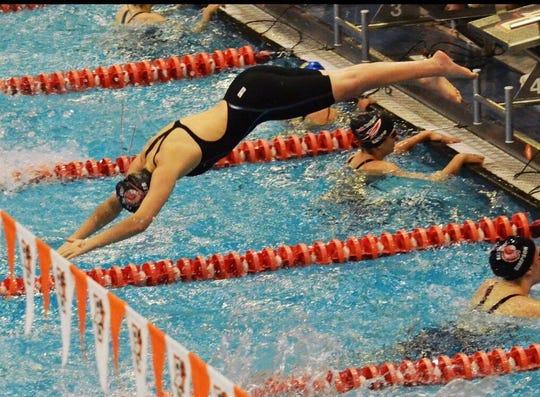 Port Clinton's Elena Kessler dives into the pool.