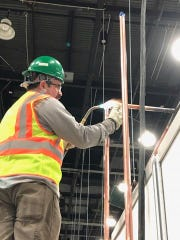 Dan Willingham, Monroe resident and Detroit Plumbers Local 98 member, does work on the oxygen system for the Detroit TCF Center, which was converted into a field hospital to take COVID-19 cases.