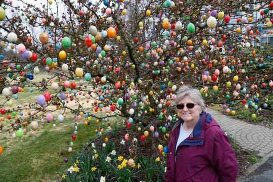 Louann Haussermann in front of her tree that is decorated with over 2,000 Easter eggs in the Town of Poughkeepsie on April 8, 2020.