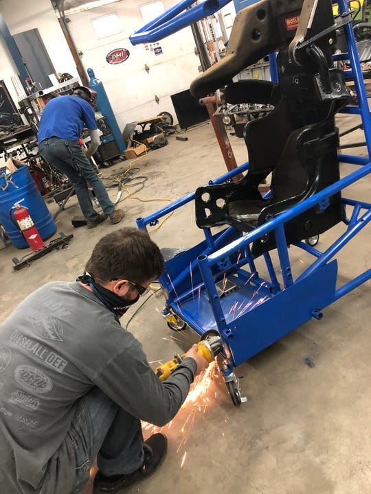 Logan Schuchart works on his new rig to compete in the World of Outlaws iRacing Sprint Car Invitational. Schuchart finished third and fifth in the first two events.