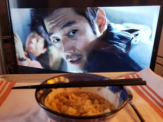 "Nongshim instant ramen paired with the 2013 film ""The Flu,"" starring Hyuk Jang."