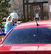 UNR Med fourth-year medical student Lauran Evans assists with drive-through COVID-19 testing at both the Washoe County Health District and University Health Internal Medicine appointment-only drive-through locations.
