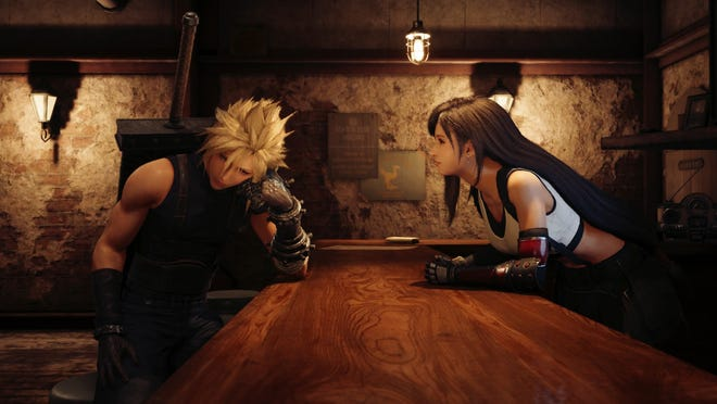 Tifa chats with Cloud inside the 7th Heaven bar in Final Fantasy VII Remake.