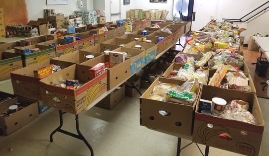Boxes of food await delivery by the Shasta Youth Alliance to families in need.