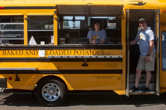 Amy and Ken Carey have been giving away cheesy baked potatoes to children every Wednesday and Friday from 11 a.m. to 1 p.m., at Stayton Elementary School on April 8, 2020.