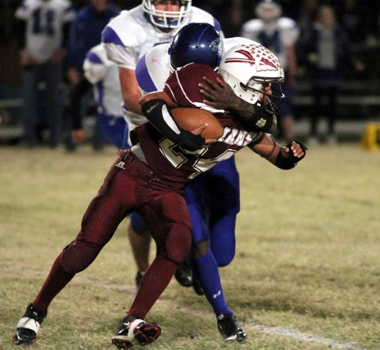 Paint Rock's Jonathan Santiago tries to break free from a Novice tackler Nov. 5, 2010.
