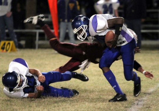 Novice's Tevin Starkey breaks a tackle and scores a touchdown against Paint Rock on Nov. 5, 2010.