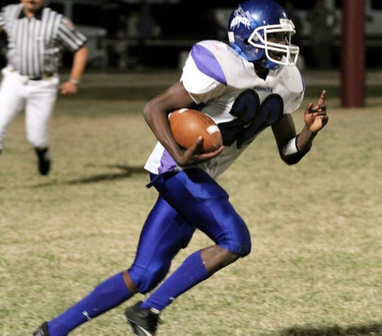 Novice's Tevin Starkey runs the ball down the field against Paint Rock on Nov. 5, 2010.