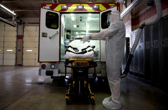 Steven Gassiot prepares to disinfect an ambulance in the San Angelo Fire Department fleet at the Central Fire Station on Thursday, April 9, 2020.