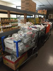 The Salvation Army and food pantries throughout the county have changed how they distribute food to prevent the spread of the coronavirus, offering to-go and drive-through options.