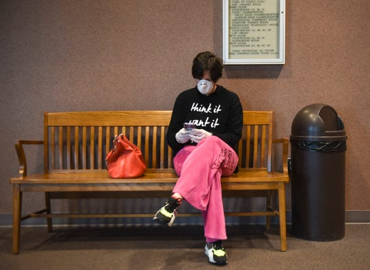 Kari Randle wears a mask to prevent the spread of the coronavirus on Thursday, April 9, 2020 at the Minnehaha County Clerk-Courts in Sioux Falls S.D.