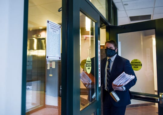 Cody Raterman wears a mask to prevent the spread of the coronavirus on Thursday, April 9, 2020 at the Minnehaha County Clerk-Courts in Sioux Falls S.D.
