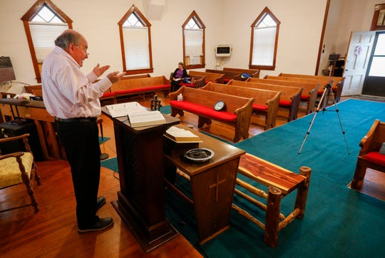 Rev. Robert Dodson preaches to a Facebook Live audience in an empty Concord Baptist Church on Wednesday in Walnut Grove.