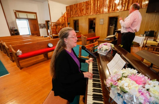 The Rev. Robert Dodson and his wife, Donna, sing to a Facebook Live audience in an empty Concord Baptist Church on Wednesday in Walnut Grove.