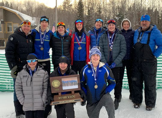 Sartell/Cathedral boys Nordic ski team smiles with their state championship trophy Thursday, Feb. 14, 2019, at Giants Ridge in Biwabik.