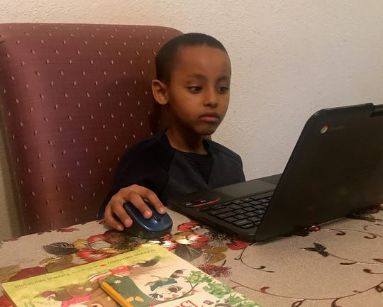 Muad Issack, a first-grader at Oak Hill Elementary in St. Cloud, uses a computer to complete schoolwork. Minnesota students began distance learning on March 30 due to the COVID-19 pandemic.