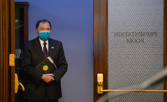 Utah Gov. Gary Herbert wears a face mask during the daily COVID-19 media briefing at the Utah State Capitol, in Salt Lake City on Wednesday, April 8, 2020. (Francisco Kjolseth/The Salt Lake Tribune via AP, Pool)