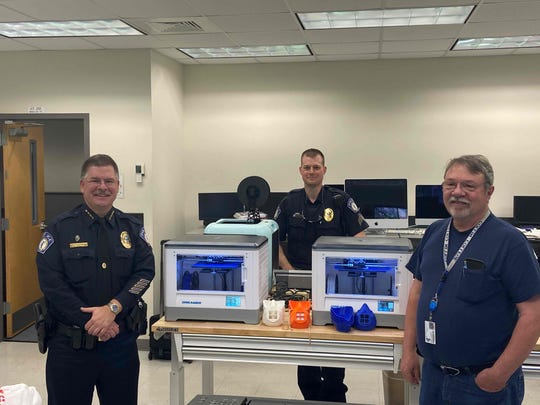 (L-R) TCC Police Chief Greg Gibson, TCC Police Officer Bill Bell and Mike Vickers, manager of TCC's Computer Technology Building, with a display of 3-D printable face masks.