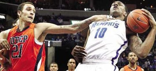 3. UTEP 60, Memphis 58, Feb. 18, 2012  Memphis' Tarik Balck, right, receives a chop to the neck from UTEP's John Bohannon while grabbing a rebound on Saturday at the FedExForum in Memphis, Tenn.