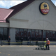 New state-ordered coronavirus precautions started Thursday for retail businesses, like this ShopRite in Glassboro. New Jersey wants customer numbers cut in half inside stores, leading to ques like this one, and everyone to don masks.