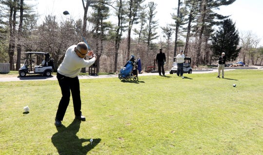 Carl Rogers of Yonkers tees off on the 10th hole at Maple Moor Golf Course in White Plains April, 6, 2020. Playing with him was Chris Durant of Yorktown, Jim Welsh of Mount Kisco, and Rob Wallace of Oradell, N.J. With golf courses in New Jersey closed due to the coronavirus pandemic, Wallace said he came to Maple Moor because the Westchester County public golf courses were the closest courses that remained open. New York State has now classified golf courses as non-essential businesses, meaning they will have to close at least until the April 29th.