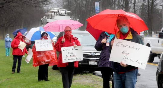 Nurses and other hospital staff practice social distancing as they called for adequate protective equipment during a protest outside Westchester Medical Center in Valhalla April 9, 2020. Nurses also called for more ventilators, adequate staffing, and better ventilation and HEPA filters for all COVID-19 areas in the hospital.