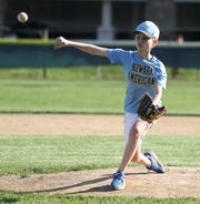 Chase Zarzycki, 11, throws a pitch as a handful of boys have an informal baseball session at the Newark American Little League field on Veterans Drive Wednesday.