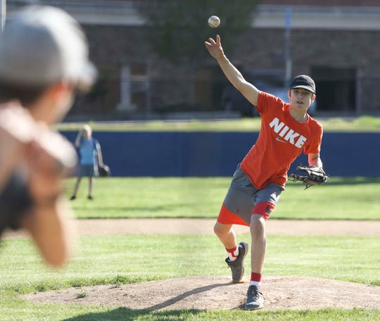Aiden Lawhorn, 15, throws during an informal workout at the Newark American Little League field on Veterans Drive Wednesday.