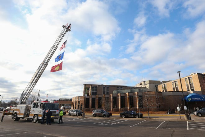 First responders gather and flash their lights on Thursday, April 9, 2020, outside of Aspirus Riverview Hospital in Wisconsin Rapids, Wis. Wood County first responders made the gesture to salute Aspirus and its employees during the COVID-19 pandemic. Tork Mason/USA TODAY NETWORK-Wisconsin