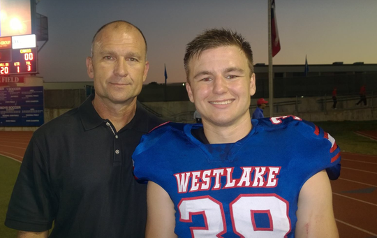 Jacob Prothro and his father on senior night, prior to Westlake's 2014 game against Del Valle.
