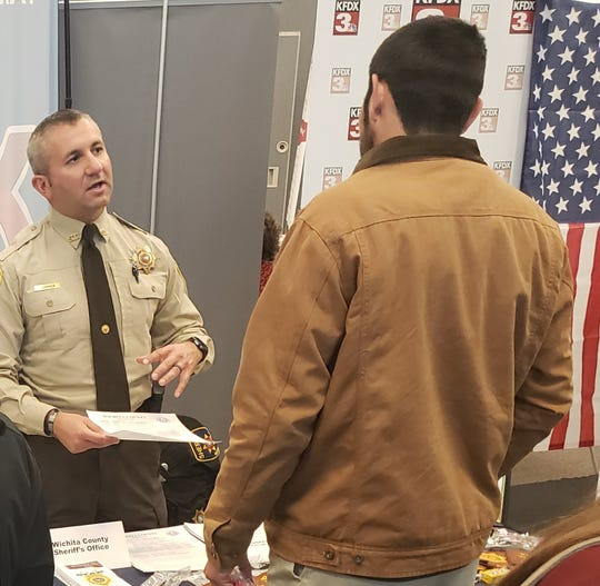 Wichita County sheriff's Deputy Brien Conner recruits at a recent Workforce Solutions North Texas job fair.