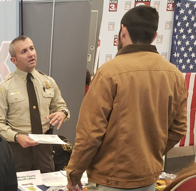 Wichita County sheriff's Deputy Brien Conner recruits at a Workforce Solutions North Texas job fair as shown in this April 9, 2020, file photo.