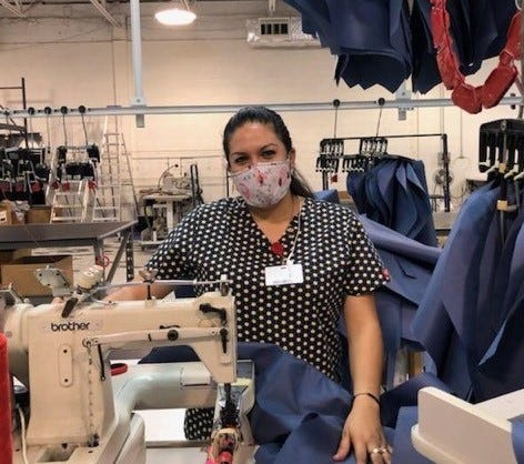 Yenifer Rodriguez sews gowns at Wichita  Falls Covercraft Industries for emergency workers to use during the pandemic.
