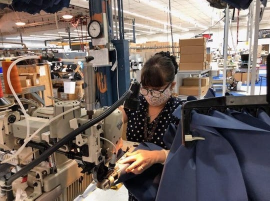Tina Doan, a Covercraft Industries worker, makes personal protective equipment at the Wichita Falls facility.