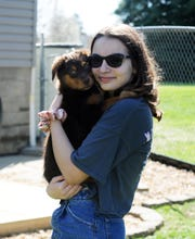Kaidence Burkett poses with a puppy the family is fostering from the Animal Shelter Society. Their mother and board president Lisa Burkett is asking others to help foster animals during the coronavirus pandemic.