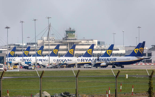 Irish low-cost carrier Ryanair has parked planes in Dublin and says it will continue to fly a reduced schedule through mid-April.
