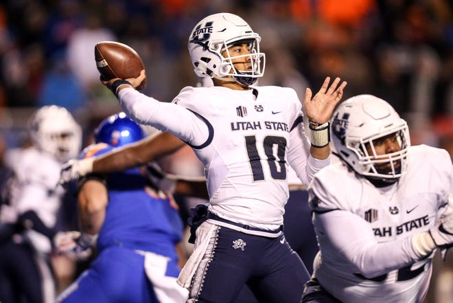 Utah State quarterback Jordan Love could benefit from some NFL seasons watching from the sidelines.