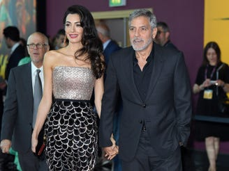 "Amal Clooney and George Clooney attend the ""Catch 22"" premiere on May 15, 2019, in London."