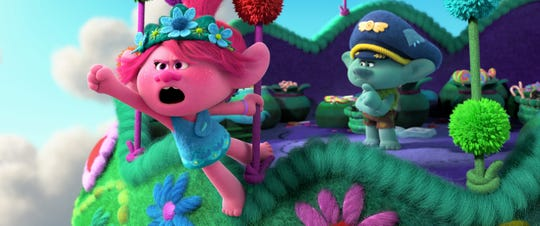 Poppy (left, voiced by Anna Kendrick) and Branch (Justin Timberlake) return in the animated sequel