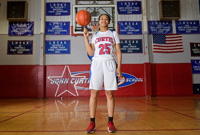 Jerkaila Jordan poses for a photo on the John Curtis High School basketball court in New Orleans, La. Wednesday, April 3, 2019.