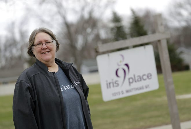 Patti Canan, a peer companion at Iris Place, has been handling calls coming on the warm line, an emotional support system for those with mental health concerns.