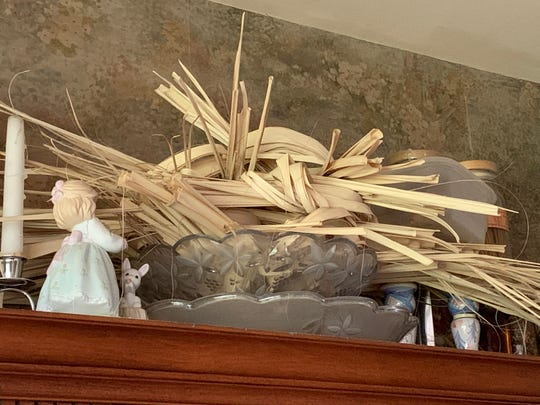 15 years worth of palm from Palm Sundays past at the Carino house.