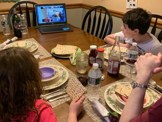 The Carino family participates in a Passover sedar Wednesday via Zoom.